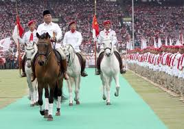 Prabowo Subianto inspects party members during a rally in Jakarta at the weekend. He wants to boost agriculture spending. - SCMP