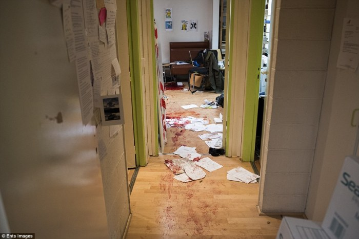 Shocking: The chilling image from the Charlie Hebdo office shows blood-stained wooden floors, papers strewn across the corridor - Daily Mail